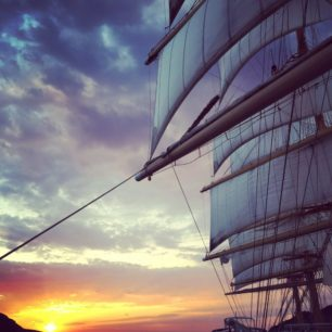 Passing Greek Islands at sunset on the Royal Clipper